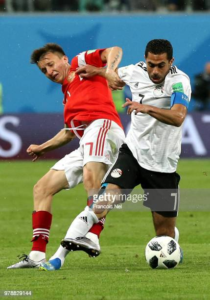 Ahmed Fathi of Egypt is tackled by Aleksandr Golovin of Russia during the 2018 FIFA World Cup Russia group A match between Russia and Egypt at Saint...