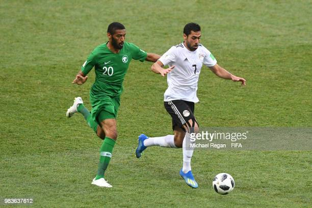 Ahmed Fathi of Egypt runs with the ball under pressure from Muhannad Asiri of Saudi Arabia during the 2018 FIFA World Cup Russia group A match...
