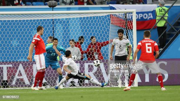 Ahmed Fathi of Egypt scores an own goal past team mate Mohamed Elshenawy to put Russia in front 10 during the 2018 FIFA World Cup Russia group A...