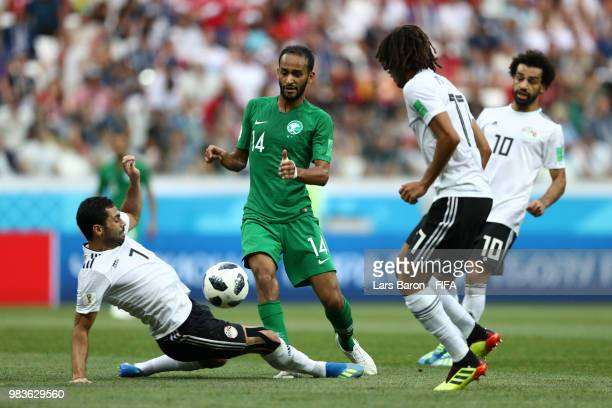 Ahmed Fathi of Egypt tackles Abdullah Otayf of Saudi Arabia during the 2018 FIFA World Cup Russia group A match between Saudia Arabia and Egypt at...