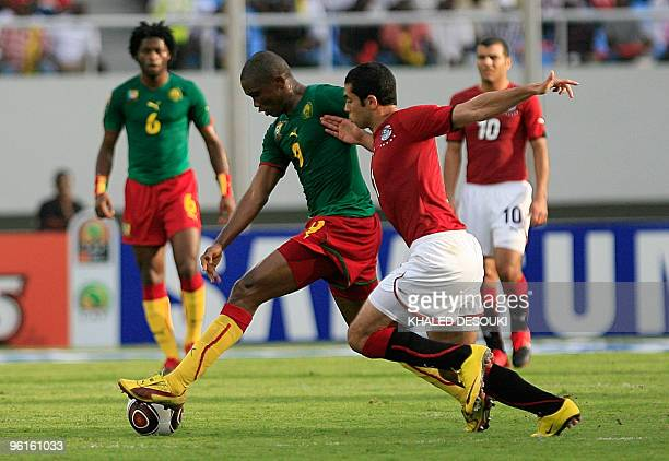 Ahmed Fathi of Egypt vies for the ball with Eto�o Samuel of Cameroon during their quarter final match in the African Cup of Nations CAN2010 at the...