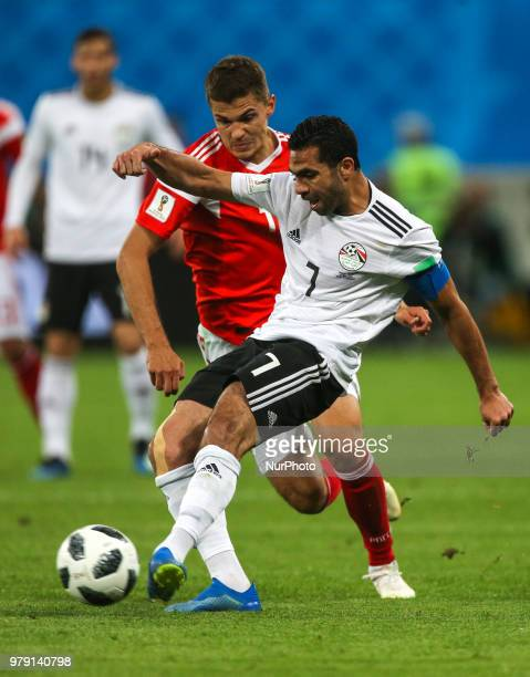 Ahmed Fathi of the Egypt national football team vie for the ball during the 2018 FIFA World Cup match first stage Group A between Russia and Egypt at...