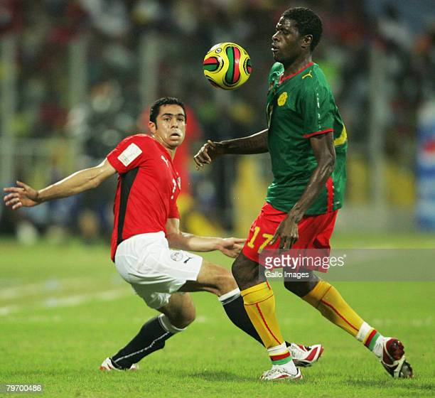 Ahmed Fathy of Egypt and Mohammadou Idrissou of Cameroon via for the ball of Cameroon during the AFCON Final match between Cameroon and Egypt at the...