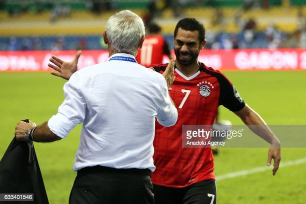 Ahmed Fathy of Egypt celebrates winning with head coach Hector Cuper after the 2017 Africa Cup of Nations semifinal football match between Burkina...