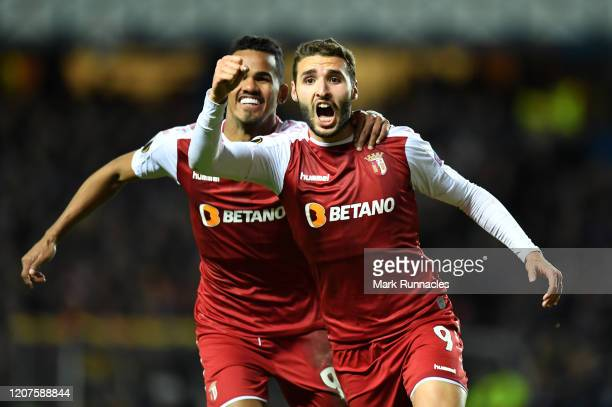 Ahmed Hassan of Braga celebrates with Galeno after scoring his team's second goal during the UEFA Europa League round of 32 first leg match between...