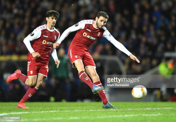 Ahmed Hassan of Braga scores his team's second goal during the UEFA Europa League round of 32 first leg match between Rangers FC and Sporting Braga...