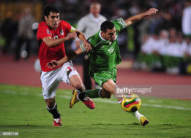 Ahmed Hassan of Egypt challenges Karim Ky Ziani of Algeria during the FIFA2010 World Cup qualifying match between Egypt and Algeria at the Cairo...