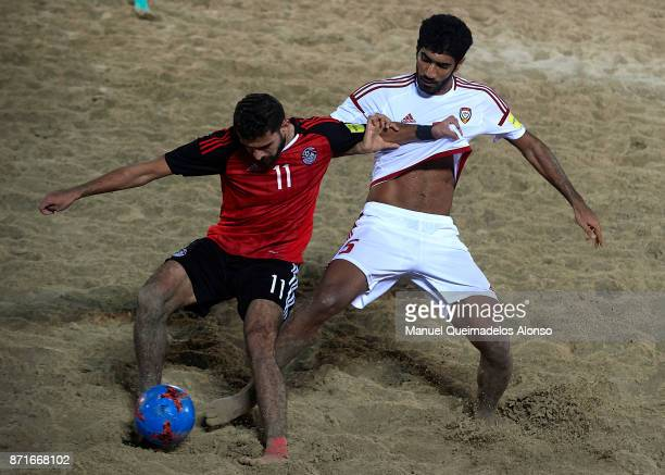 Ahmed Hassan of Egypt competes for the ball with Abbas Ali Daryaei of United Arab Emirates during the Huawei Intercontinental Beach Soccer Cup match...