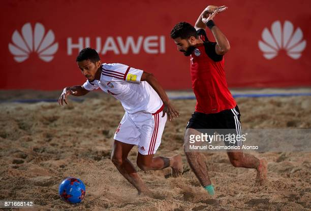 Ahmed Hassan of Egypt competes for the ball with Waleed Beshr of United Arab Emirates during the Huawei Intercontinental Beach Soccer Cup match...