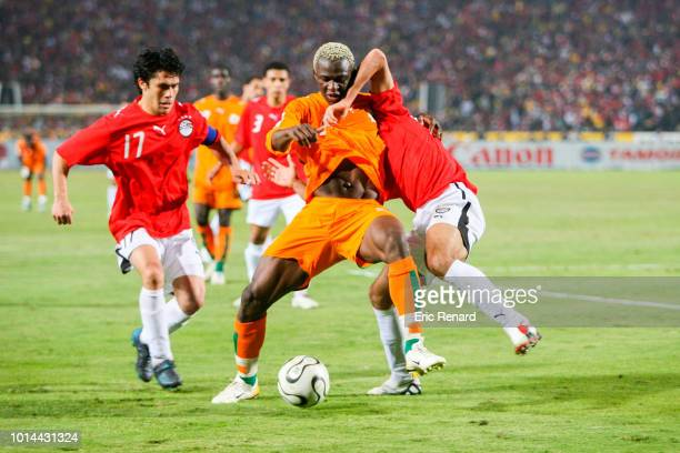 Ahmed Hassan of Egypt Kone Arouna of Ivory Coast and Ahmed Fathi of Egypt during the 2006 Africa Cup of Nations Final match between Egypt and Ivory...