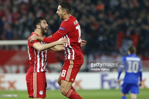 Ahmed Hassan of Olympiacos celebrates with his teammate after scoring a goal during the UEFA Europa League Round of 32 match between Olympiacos and...