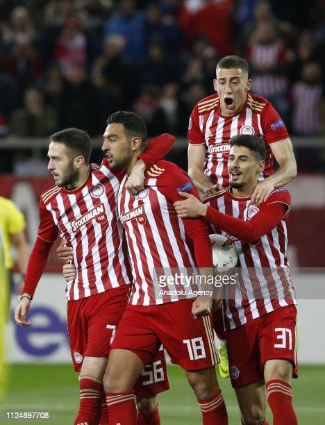 Ahmed Hassan of Olympiacos celebrates with his teammates after scoring a goal during the UEFA Europa League Round of 32 match between Olympiacos and...