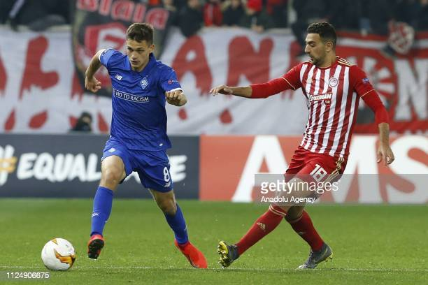 Ahmed Hassan of Olympiacos in action against Volodymyr Shepeliev of Dynamo Kyiv during the UEFA Europa League Round of 32 match between Olympiacos...