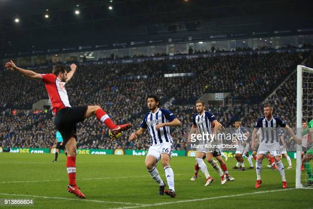 Ahmed Hegazi Craig Dawson and Chris Brunt of West Bromwich Albion look on as Jack Stephens of Southampton crosses the ball during the Premier League...