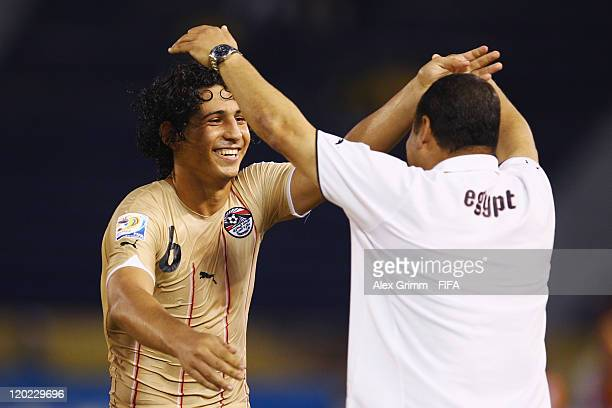 Ahmed Hegazi of Egypt celebrates his team's first goal with head coach Diaa El Sayed during the FIFA U20 World Cup Group E match between Egypt and...
