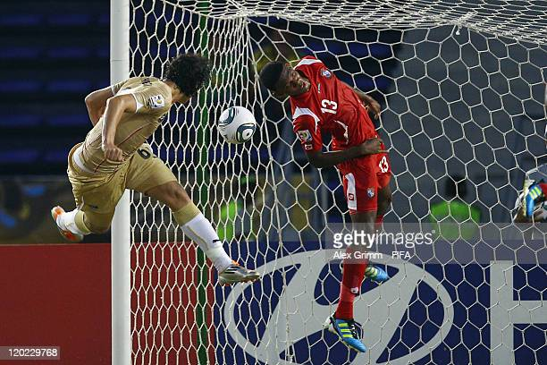 Ahmed Hegazi of Egypt scores his team's first goal against Roderick Miller of Panama during the FIFA U20 World Cup Group E match between Egypt and...