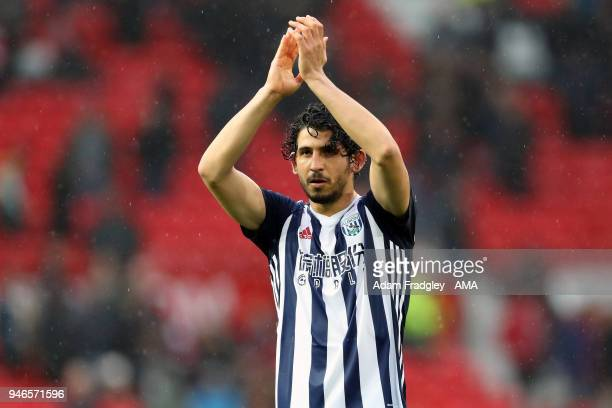 Ahmed Hegazi of West Bromwich Albion applauds the travelling West Bromwich Albion Fans after a 01 win during the Premier League match between...