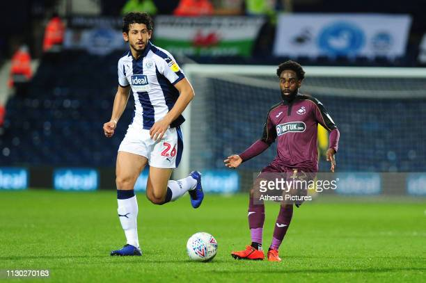 Ahmed Hegazi of West Bromwich Albion battles with Nathan Dyer of Swansea City during the Sky Bet Championship match between West Bromwich Albion and...