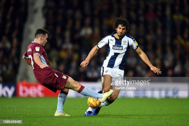 Ahmed Hegazi of West Bromwich Albion is tackled by John McGinn of Aston Villa during the Sky Bet Championship match between West Bromwich Albion and...