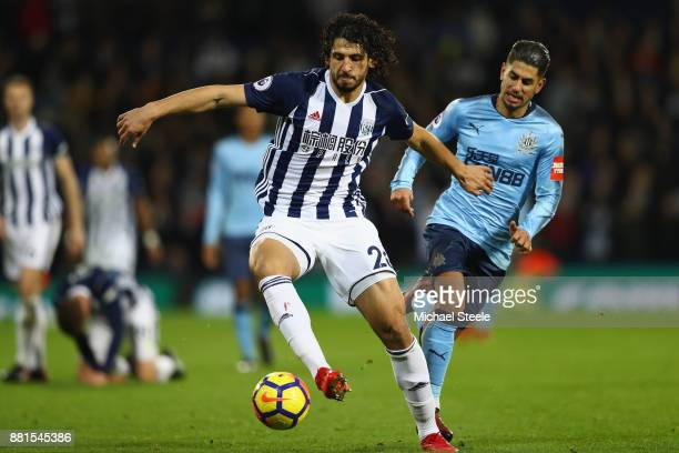 Ahmed Hegazi of West Bromwich Albion shields the ball from Ayoze Perez of Newcastle United during the Premier League match between West Bromwich...