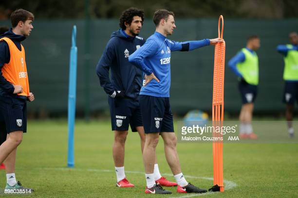 Ahmed Hegazy and Jonny Evans of West Bromwich Albion on December 19 2017 in West Bromwich England