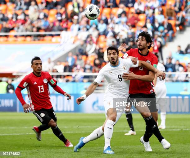 Ahmed Hegazy of Egypt battles for possession with Luis Suarez of Uruguay during the 2018 FIFA World Cup Russia group A match between Egypt and...