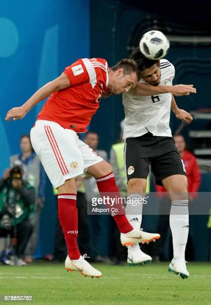Ahmed Hegazy of Egypt clashes with Artem Dzyuba of Russia during the 2018 FIFA World Cup Russia group A match between Russia and Egypt at Saint...