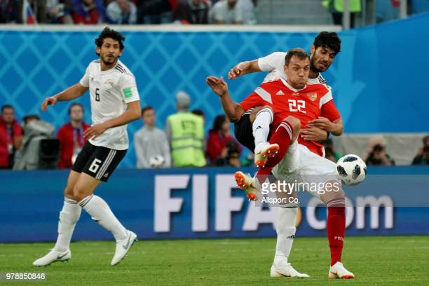 Ahmed Hegazy of Egypt holds off Artem Dzyuba of Russia during the 2018 FIFA World Cup Russia group A match between Russia and Egypt at Saint...