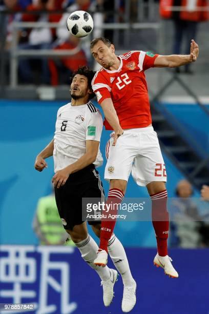 Ahmed Hegazy of Egypt in action against Artem Dzyuba of Russia during the 2018 FIFA World Cup Russia Group A match between Russia and Egypt at the...