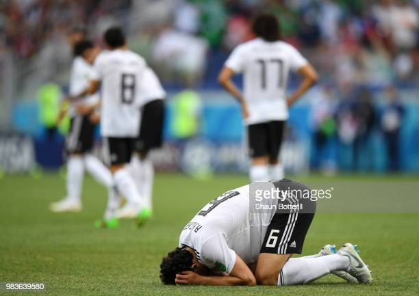 Ahmed Hegazy of Egypt sinks to the floor in dejection following the second Saudi Arabia goal during the 2018 FIFA World Cup Russia group A match...