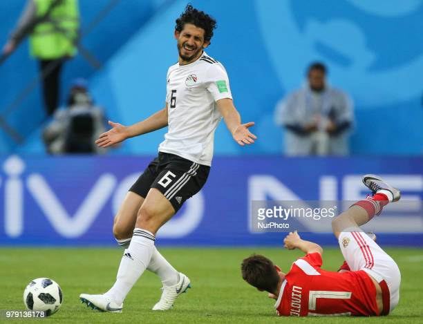 Ahmed Hegazy of the Egypt national football team and Aleksandr Golovin of the Russia national football team vie for the ball during the 2018 FIFA...