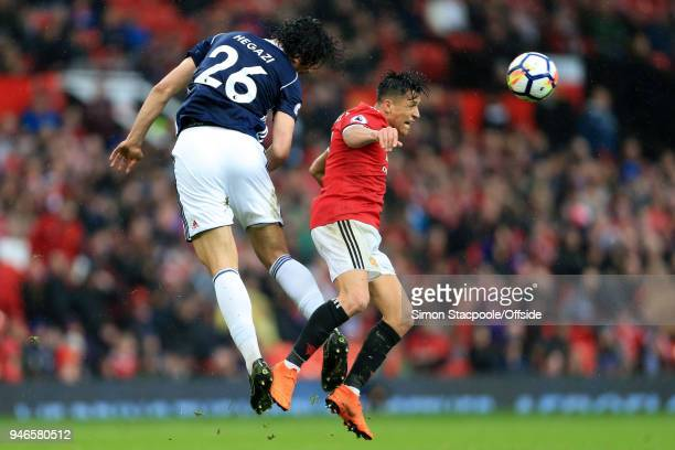 Ahmed Hegazy of West Brom battles with Alexis Sanchez of Man Utd during the Premier League match between Manchester United and West Bromwich Albion...
