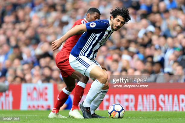 Ahmed Hegazy of West Brom battles with Georginio Wijnaldum of Liverpool during the Premier League match between West Bromwich Albion and Liverpool at...