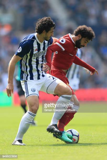 Ahmed Hegazy of West Brom battles with Mohamed Salah of Liverpool during the Premier League match between West Bromwich Albion and Liverpool at The...
