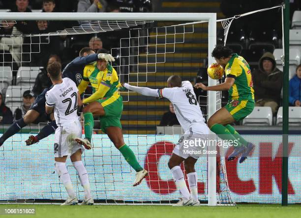 Ahmed Hegazy of West Brom scores to make it 21 during the Sky Bet Championship match between Swansea City and West Bromwich Albion at the Liberty...