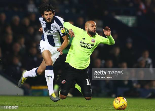 Ahmed Hegazy of West Bromwich Albion and David McGoldrick of Sheffield United challenge for the ball during the Sky Bet Championship match between...