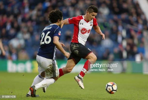 Ahmed Hegazy of West Bromwich Albion and Guido Carrillo of Southampton during The Emirates FA Cup Fifth Round match between West Bromwich Albion and...