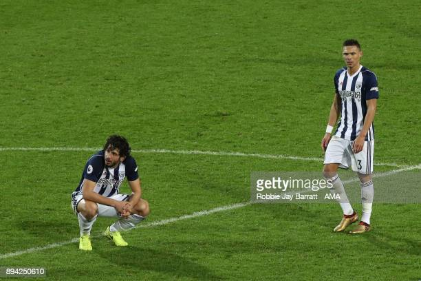 Ahmed Hegazy of West Bromwich Albion and Kieran Gibbs of West Bromwich Albion dejected at full time during the Premier League match between West...