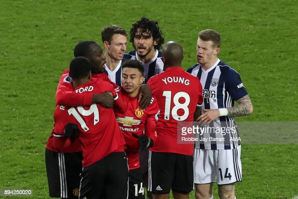 Ahmed Hegazy of West Bromwich Albion and Marcus Rashford of Manchester United have a disagreement during the Premier League match between West...