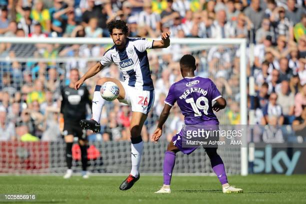 Ahmed Hegazy of West Bromwich Albion and Saido Berahino of Stoke City during the Sky Bet Championship match between West Bromwich Albion and Stoke...