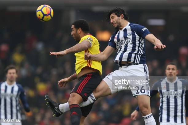 Ahmed Hegazy of West Bromwich Albion and Troy Deeley of Watford during the Premier League match between Watford and West Bromwich Albion at Vicarage...