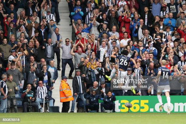 Ahmed Hegazy of West Bromwich Albion celebrates after scoring a goal to make it 10 during the Premier League match between West Bromwich Albion and...