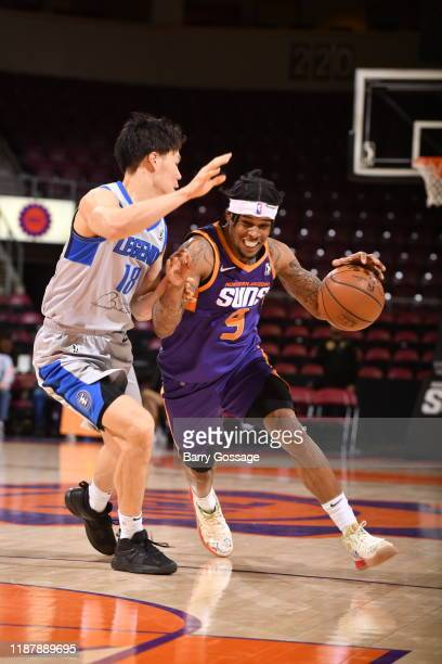 Ahmed Hill of the Northern Arizona Suns dribbles against Yudia Baba of the Texas Legends on December 10 at the Findlay Toyota Center in Prescott...