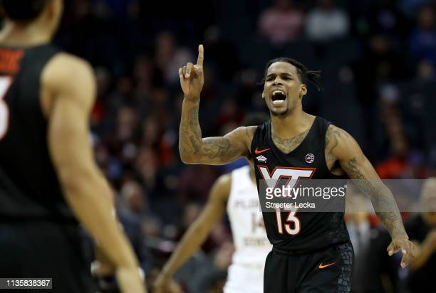 Ahmed Hill of the Virginia Tech Hokies calls to a teammate against the Florida State Seminoles during their game in the quarterfinal round of the...