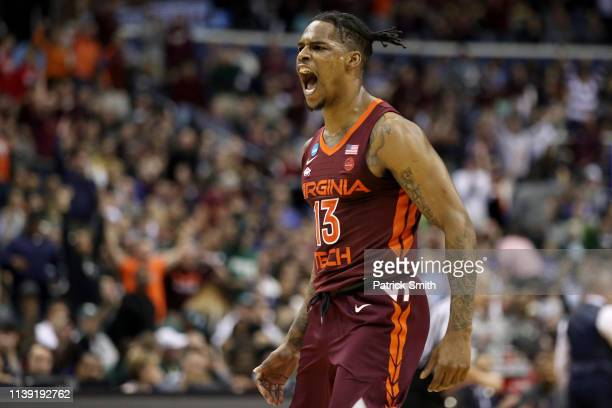 Ahmed Hill of the Virginia Tech Hokies celebrates a basket against the Duke Blue Devils during the first half in the East Regional game of the 2019...