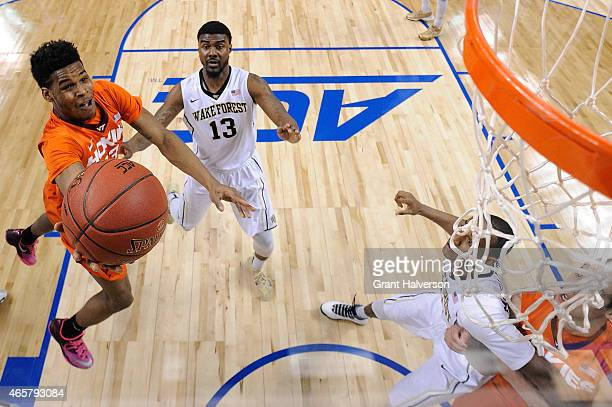 Ahmed Hill of the Virginia Tech Hokies drives to the basket against the Wake Forest Demon Deacons during a first round game of the ACC basketball...