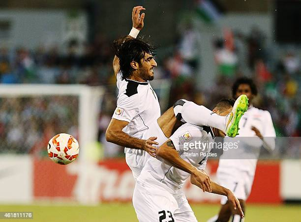 Ahmed Ibrahim of Iraq and Waleed Salim AlLami of Iraq come together during the 2015 Asian Cup match between Iraq and Palestine at Canberra Stadium on...