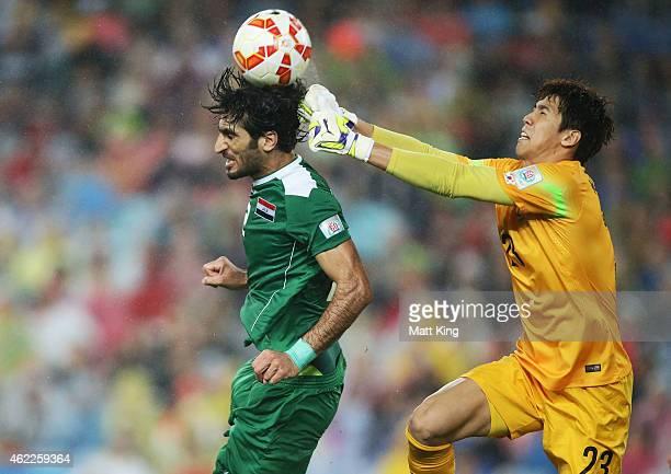Ahmed Ibrahim of Iraq heads the ball as goalkeeper Kim Jin Hyeon of Korea Republic defends during the Asian Cup Semi Final match between Korea...