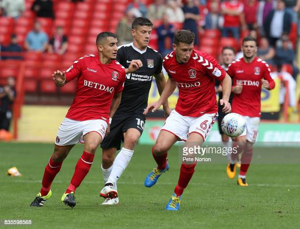 Ahmed Kashi and Jason Pearce of Charlton Athletic contest the ball with Alex Revell of Northampton Town during the Sky Bet League One match between...