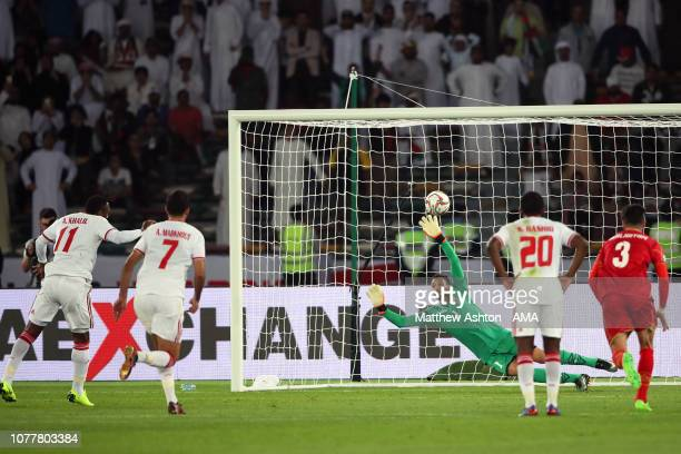 Ahmed Khalil Aljunaibi of the United Arab Emirates scores his side's first goal to make the score 11 during the AFC Asian Cup Group A match between...